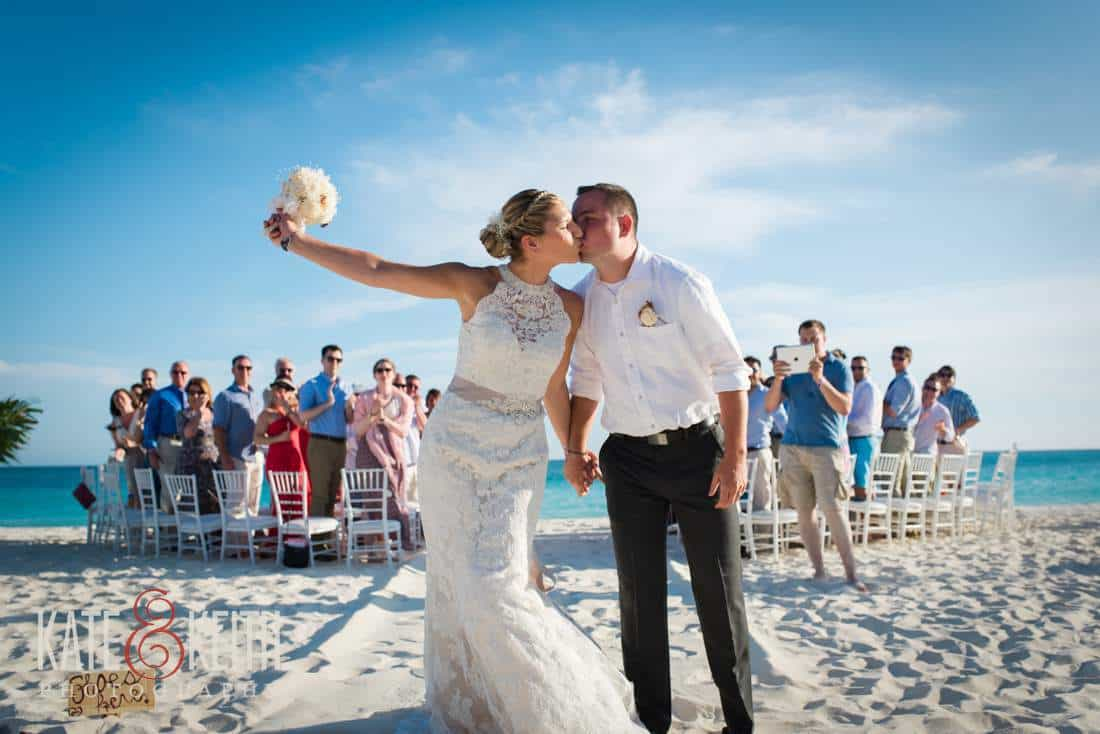 First kiss Caribbean beach wedding ceremony