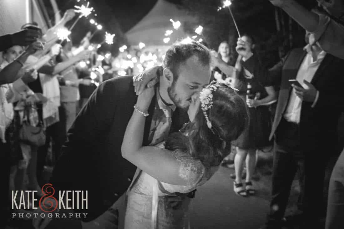Bride and Groom sparkler exit kiss Waterville Valley