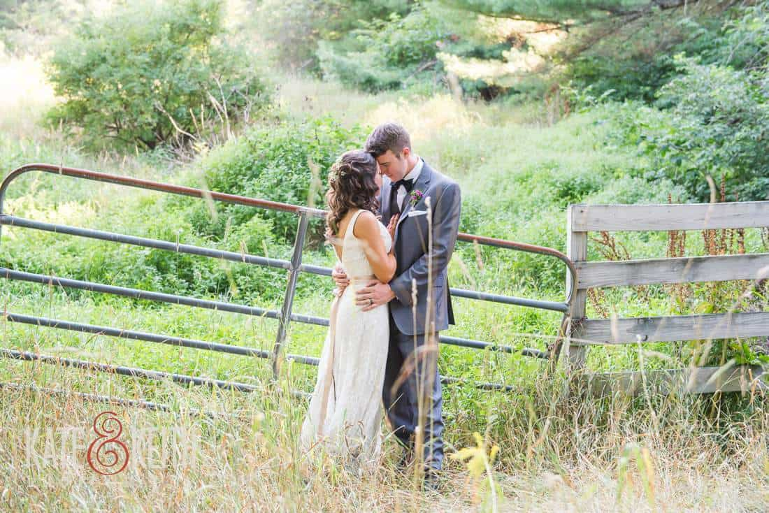 Country Bride and groom in field
