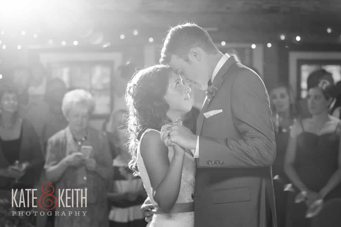Bride and groom first dance in barn