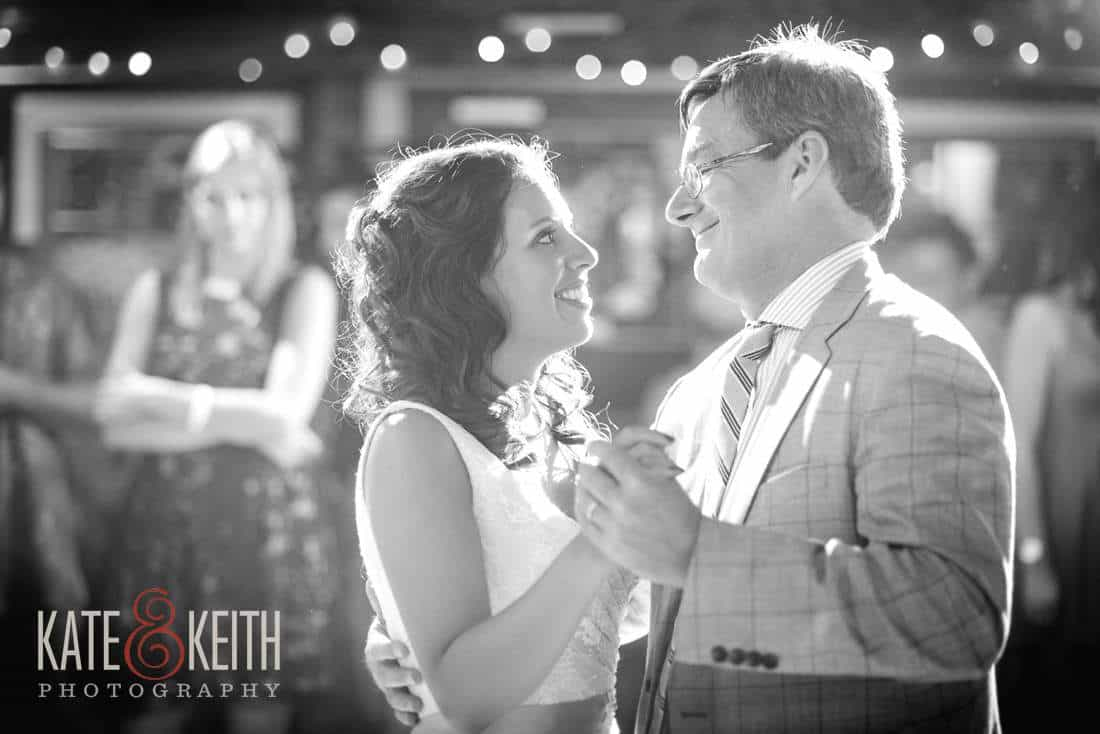 Bride and father dance in Barn