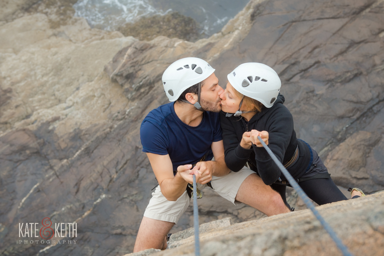 Adventure photography, anniversary shoot, rock climbing Otter Cliffs, Acadia National Park, adventurous couple