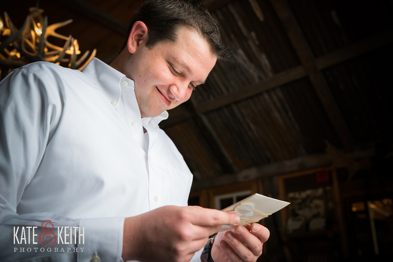 Barn at the Pemi, New Hampshire wedding venue, groom, smiling groom, getting ready, love note, bride gift, groom gift