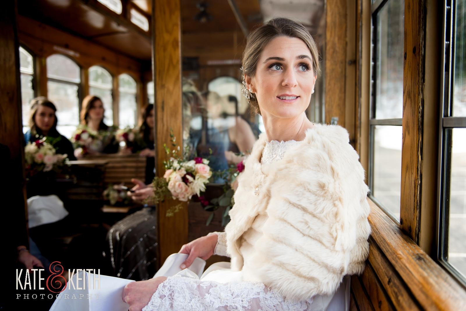 Barn on the Pemi, Your Dream Bridal shop, Winter wedding, New Hampshire, wedding trolley, fur cap, winter wedding dress, fur wrap, cold weather wedding, old fashioned trolley, wedding party, bridal party