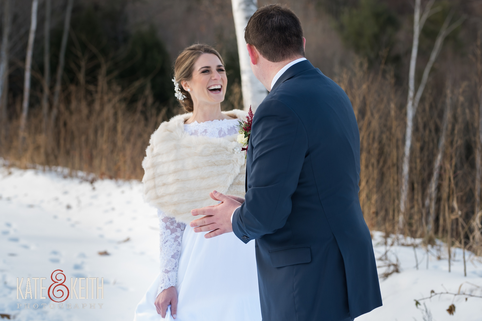 Barn on the Pemi, First look, wedding first look, snow, winter wedding, candid moment, fur wrap, winter wedding dress, long sleeved winter wedding dress, cold weather wedding, bride and groom first look laughing, Your Dreams Bridal shop, Men's Warehouse, Joseph Abud