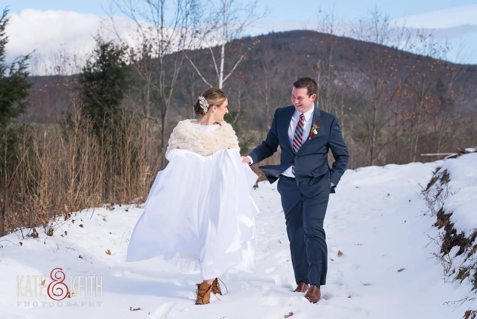 Barn on the Pemi, Boathouse Blooms florist, Your Dreams Bridal shop, Men's Warehouse, Joseph Abud, LL Bean boots, First look, wedding first look, snow, winter wedding, candid moment, adventure wedding, outdoor wedding, winter wedding dress, long sleeved winter wedding dress, cold weather wedding, bride and groom first look, wedding portraits, adventurous couple