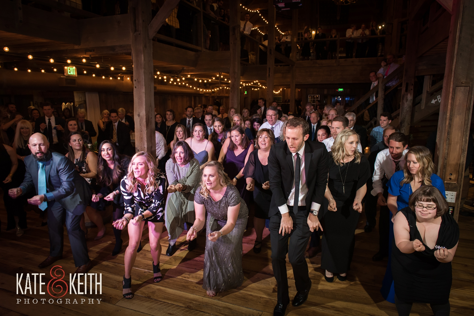 Barn on the Pemi wedding, New Hampshire winter wedding, dance floor, barn reception, full dance floor, line dance, wedding party, dancing wedding guests