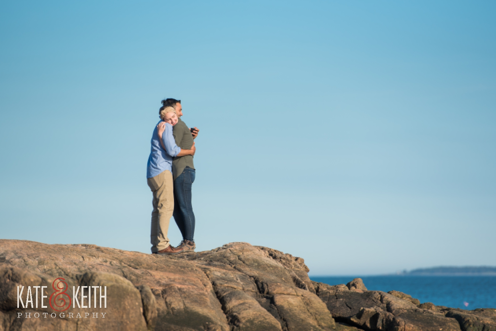 Couple celebrating engagement in Acadia National Park, Maine, Mount Desert Island, surprise proposal, wedding proposal, coast, ocean, seaside