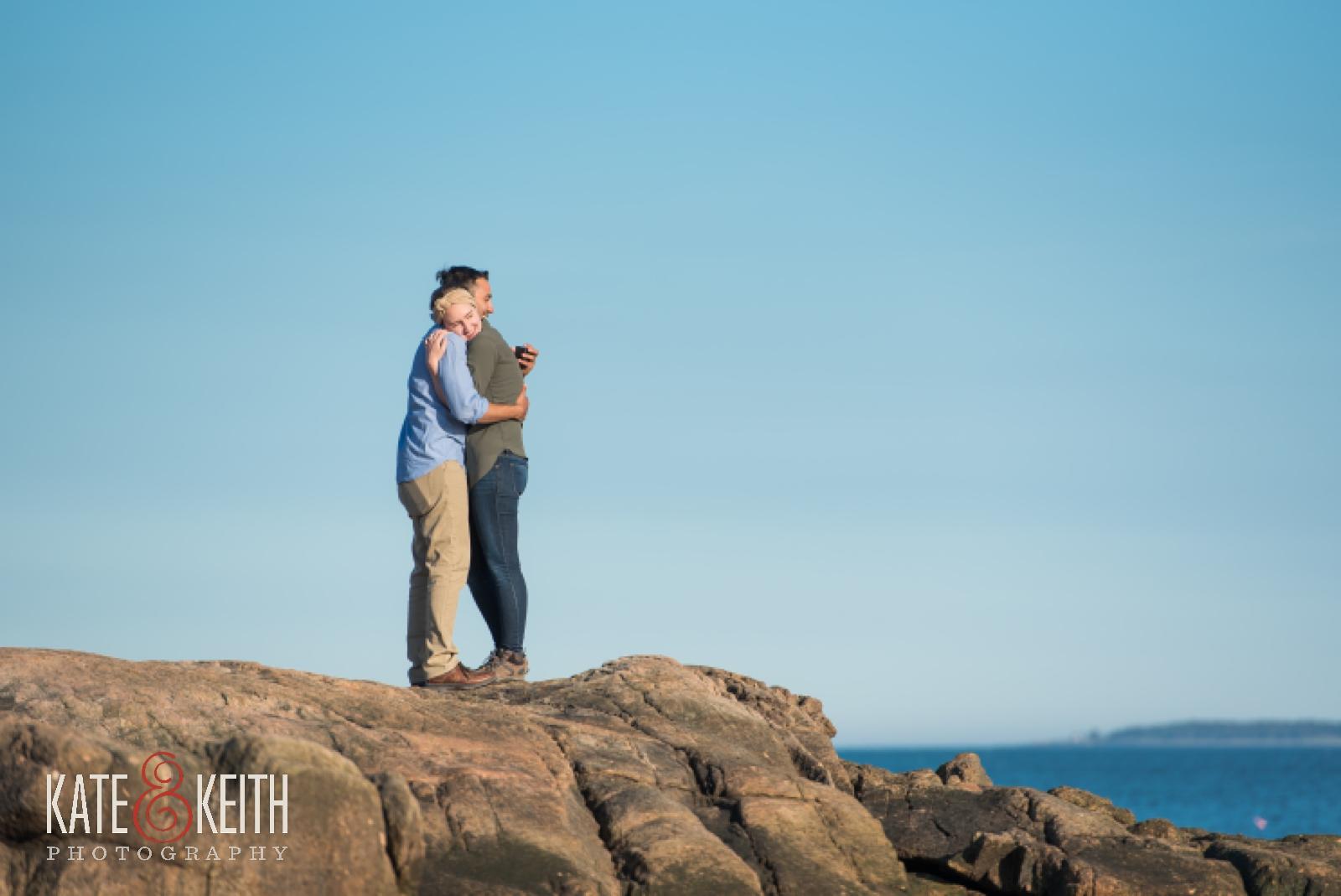 Couple celebrating engagement in Acadia National Park, Maine, Mount Desert Island, surprise proposal, wedding proposal, coast, ocean, seaside