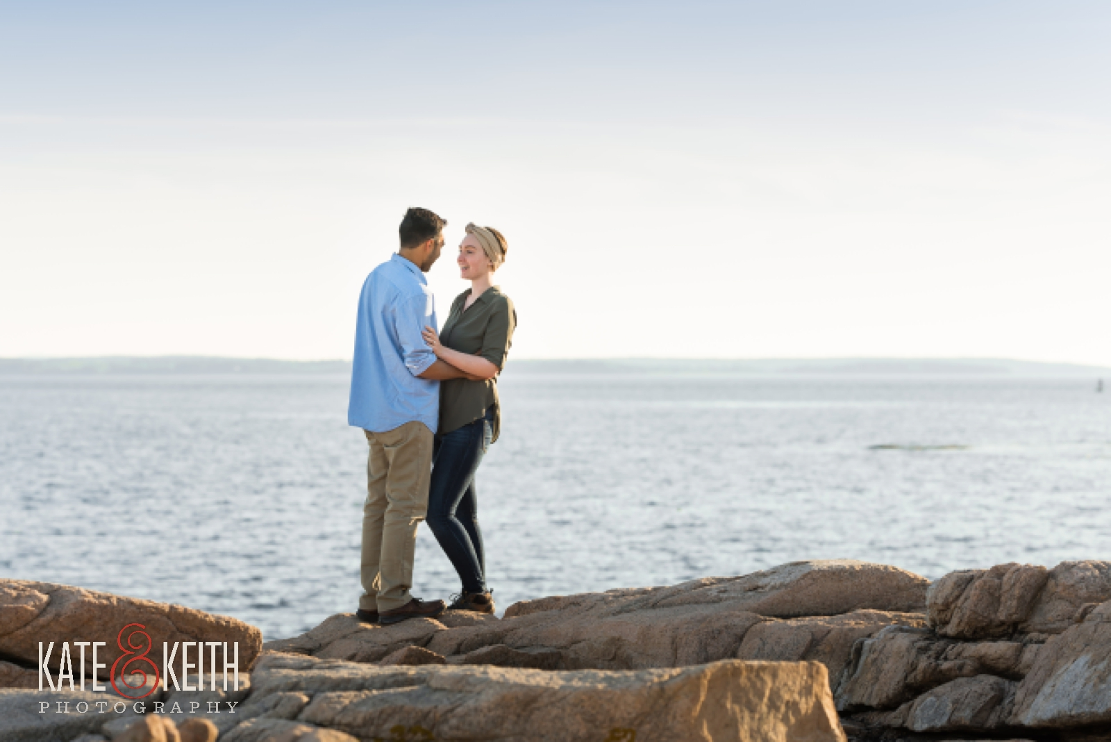 Couple celebrating engagement in Acadia National Park, Maine, Mount Desert Island, surprise proposal, wedding proposal, coast, ocean, seaside, rocky coast
