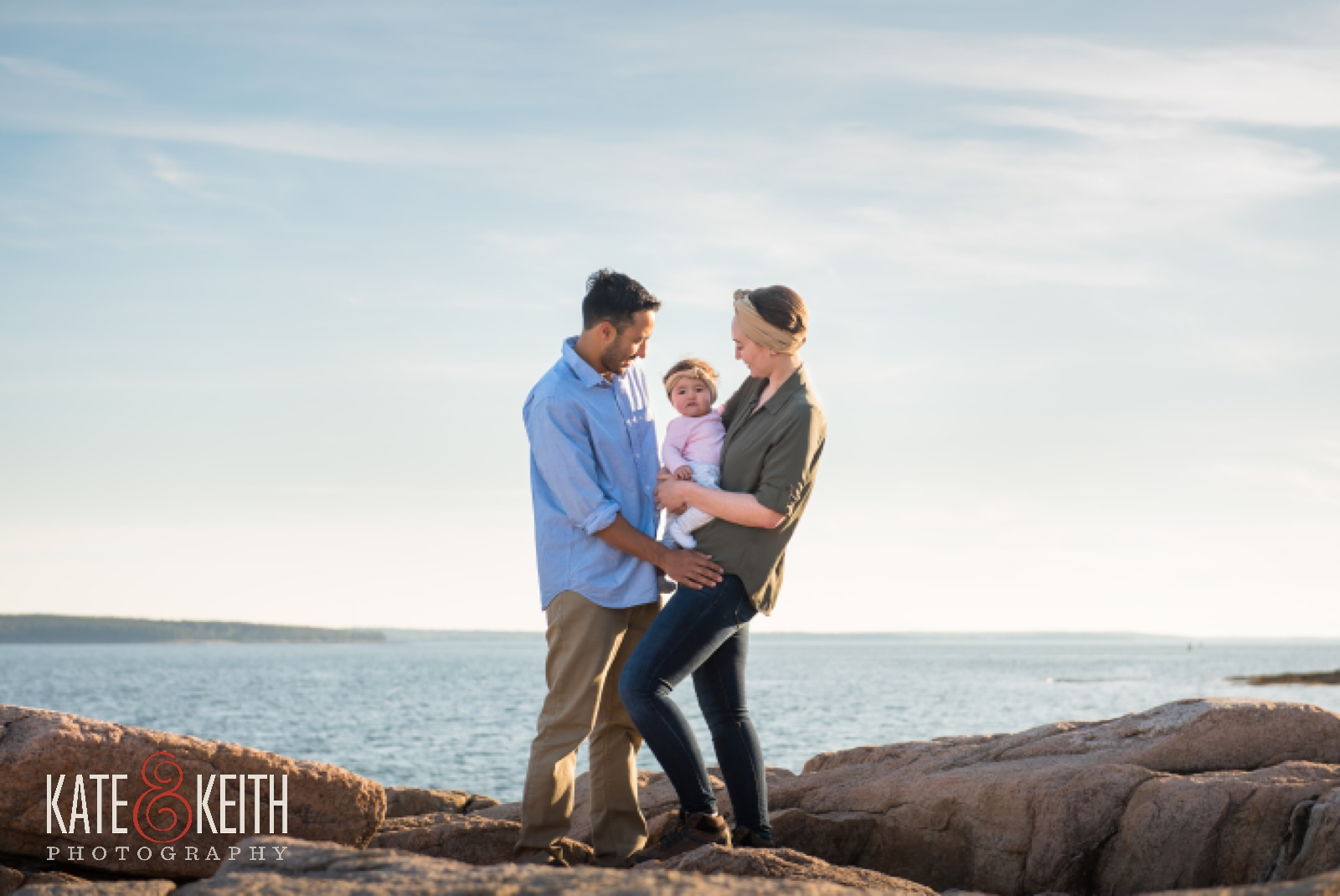 Couple celebrating engagement in Acadia National Park, Maine, Mount Desert Island, surprise proposal, proposal photos, wedding proposal, coast, ocean, seaside, young family, couple with baby, engagement photos