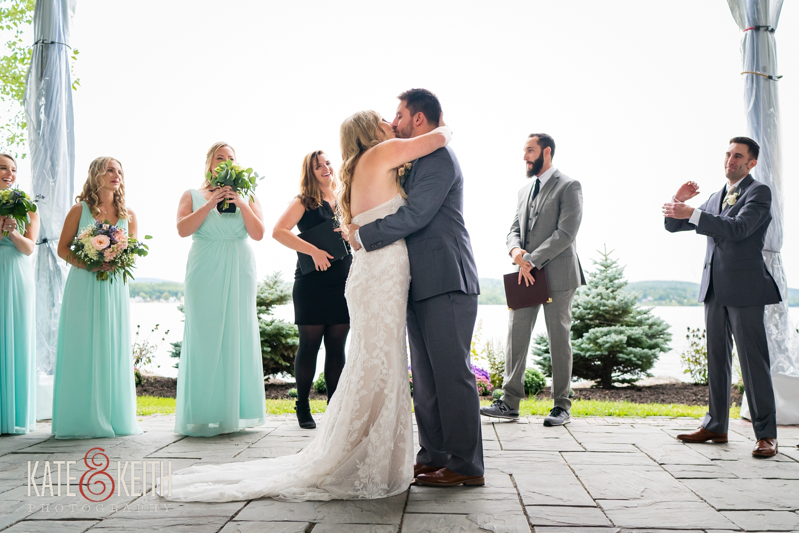New Hampshire, Lakes Region, Lake Winnipesaukee, The Margate Resort, wedding, outdoor wedding, lakeside wedding, wedding ceremony, outdoor ceremony, tented ceremony, first kiss, wedding kiss, married, laughter and applause, wedding moments