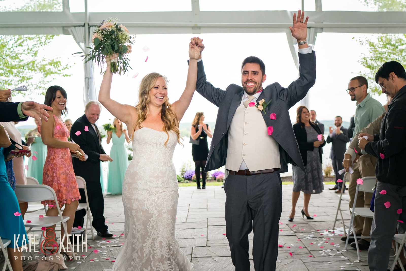 New Hampshire, Lakes Region, Lake Winnipesaukee, The Margate Resort, wedding, outdoor wedding, lakeside wedding, wedding ceremony, outdoor ceremony, tented ceremony, recessional, throwing petals, married, laughter and applause, wedding moments
