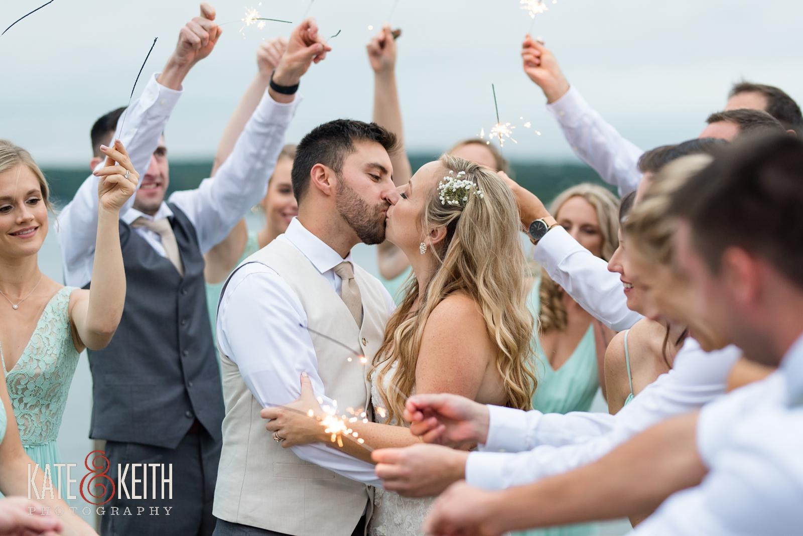 New Hampshire, Lakes Region, Lake Winnipesaukee, The Margate Resort, wedding, outdoor wedding, lakeside wedding,  bridal party, group photo, fun group photo, fun wedding portraits, silly wedding portraits, silly wedding party photos, sparklers, wedding sparklers, sparkler kiss