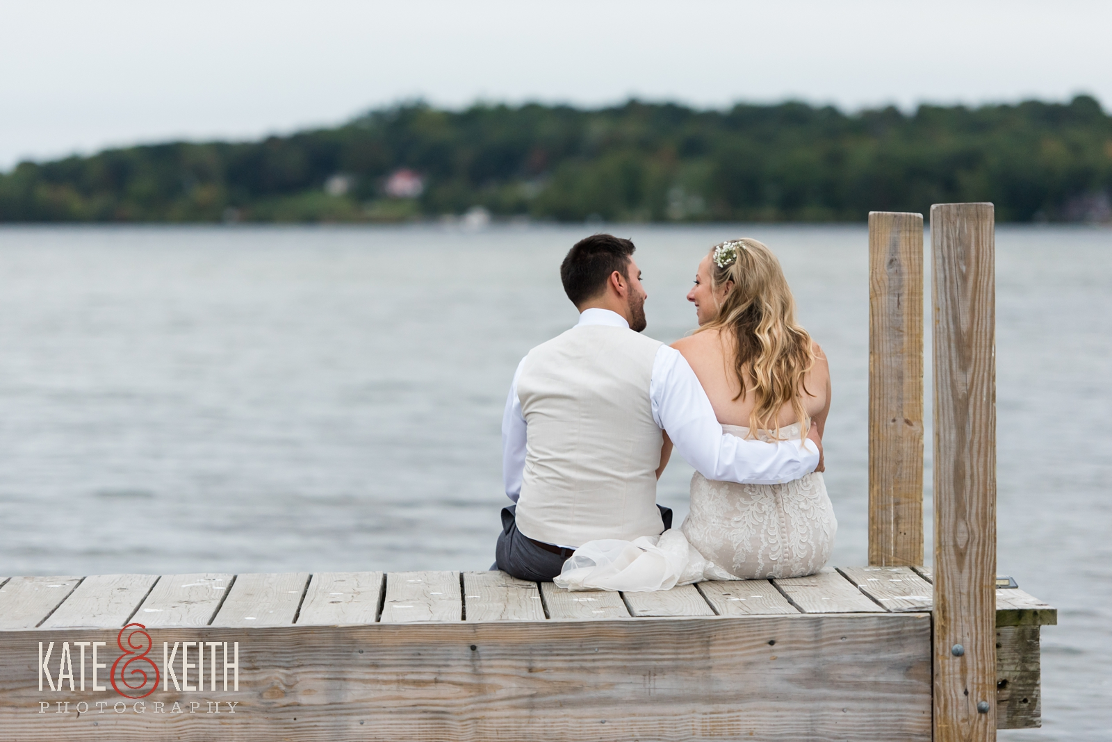 New Hampshire, Lakes Region, Lake Winnipesaukee, The Margate Resort, wedding, outdoor wedding, lakeside wedding, wedding portraits, couple portraits, couple photos, bride and groom photos, lakeside wedding portraits, dock photo, wedding photos on dock, bride and groom sitting together on dock