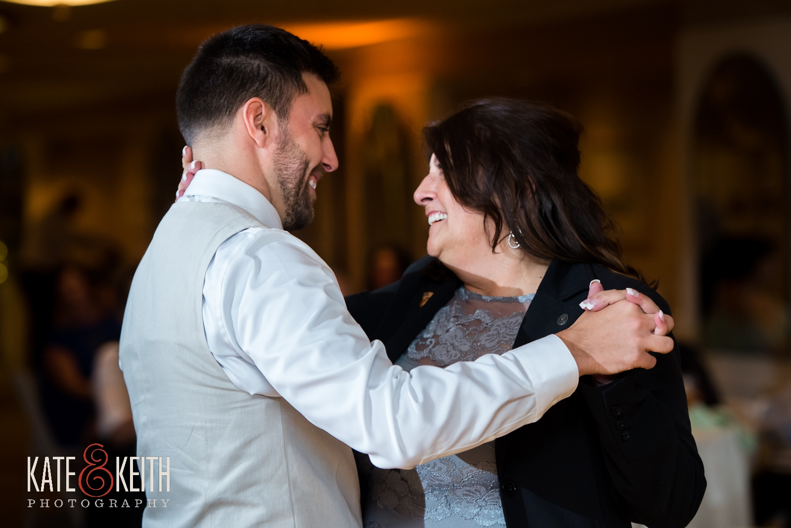 New Hampshire, Lakes Region, Lake Winnipesaukee, The Margate Resort, wedding, outdoor wedding, lakeside wedding, wedding reception, mother son dance, wedding dance, mother of the groom, candid wedding moment