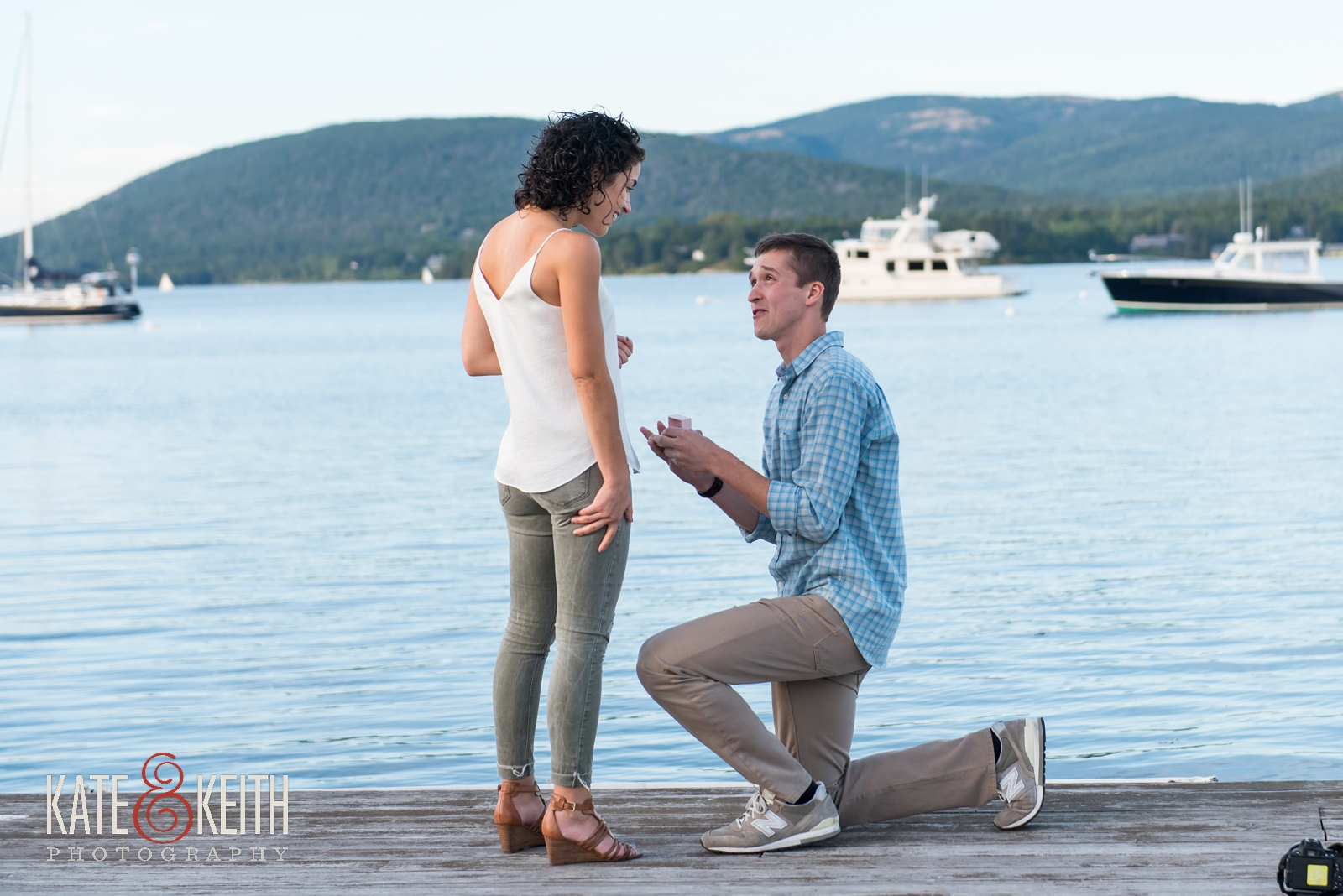 Surprise proposal, proposal in Acadia National Park, Southwest Harbor, Mount Desert Island, seaside, sunset proposal, engagement, getting engaged in Acadia National Park, rowboat, coastal Maine, New England, sailboats, dock, waterfront engagement