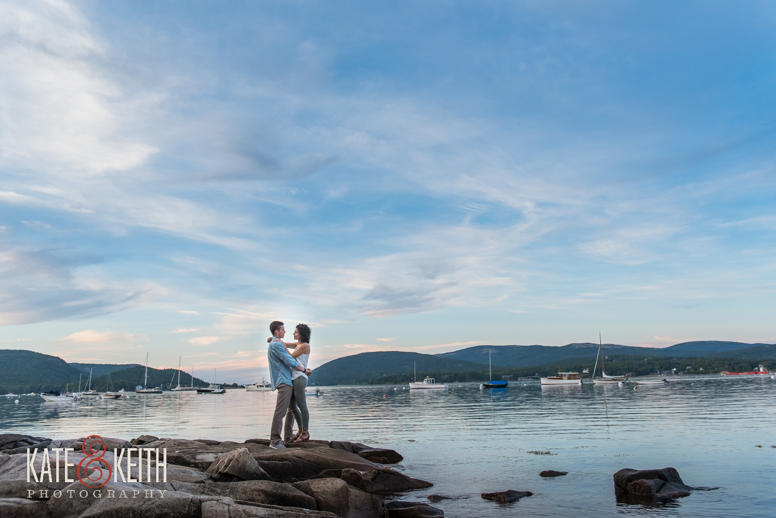 sunset proposal, proposal photos, sunset engagement, surprise proposal, proposal in Acadia National Park, Southwest Harbor, Mount Desert Island, seaside, sunset proposal, engagement, getting engaged in Acadia National Park, rowboat, coastal Maine, New England, sailboats, dock, waterfront engagement